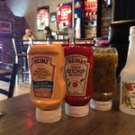 All the condiments waiting for the burger to arrive Joe Beeverz Bar & Grill  |  20 - 1300 18th S