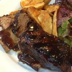 Tender and juicy marinated and grilled in tangy BBQ sauce. Served with golden potato wedges
