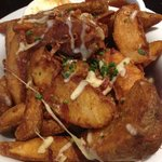 Potato Wedges $8.50 (w/ melted cheese, bacon bits, chives and sour cream