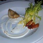 Poached Pear Salad w/ frisee, goat cheese fondue, lardon, and mint vinaigrette.