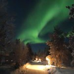 Northern lights visible from the path between the hotel and our cabin