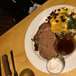 Prime rib with baked potato.
