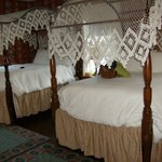 Our lovely canopy beds, so soft you could sink and get lost in them