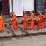 early morning monks accepting alms in the main street