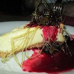 New york cheese cake with blackberry sauce