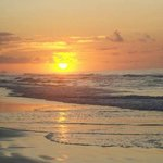 Beautiful sunrises on wide beach