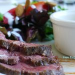 Seared beef with a side salad and paneer korma.