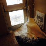 Outside doors with no weather seals. Snowdrifts in the entranceway.