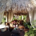 Lush Tiki hut with comfy chairs and fountain