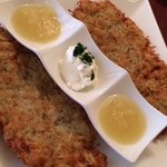 The yummy potato pancake appetizer with apple sauce and sour cream.