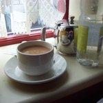 Hot tea with milk,