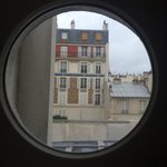Peekaboo glimpse of the Eiffel Tower from our port hole window