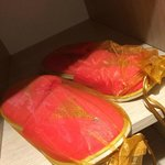 I love our festive holiday slippers which came in pretty golden gift bags