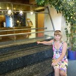 В холле отеля водопад