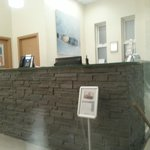 Reception Desk - there are a few leather seats here