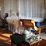 Madame enjoying 'bed tea' while the butler draws the bath