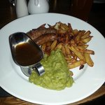Sausage, chips and mushy peas
