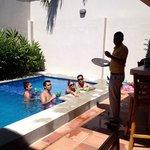 Caipirinhas by the pool sunny day