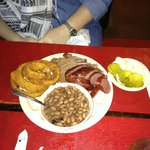 2 meat plate: beef brisket, smoked sausage, pinto beans, onion rings