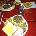 2 meat plate: Beef brisket, ham, fries, pinto beans, Texas Toast