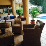 Covered Terrace Seating & Pool Views