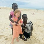 Garifuna kids and friend at the caye where lunch is served
