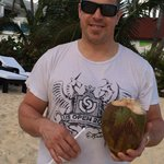 Fresh coconut water from a tree climber