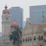 Colonial architecture with modern city background