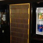 fully stocked bar and refrigerator