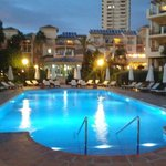 The smaller of the two outdoor pools at night