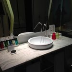 Sink with lotions, soaps and shampoos