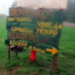 Community signage from a wet car window
