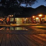 The lodge has such a rustic feel of an evening with oil lamps lighting the entrance and paths