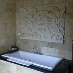 Marble bath surround with custom decorative stone work