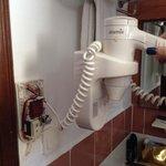 Dangerous! Hair dryer in bathroom