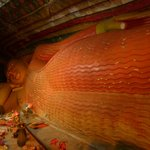The reclining Buddha statue inside the cave
