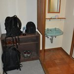 Basic sink and shoe/luggage area, just inside of room