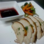 Roasted turkey serve with sauteed veggie and cranberry sauce