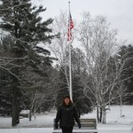 Old Glory against wintry background