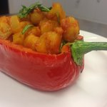 Red pepper stuffed with lightly spiced chickpeas