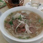 Flat rice noodle with sliced beef in broth