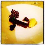 Dark chocolate and olive oil tart, pistachio Ice cream, blackberry jelly