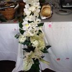 Artificial flowers on buffet in restaurant