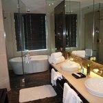 Bathroom with wet room monsoon shower/bath