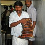 masala dosas by armful, carried hot to tables