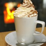 Lovely hot chocolate with cream by the wood burner