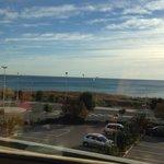 Sea view across parking