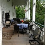 The side porch with plenty of seating to relax and enjoy the outdoors.