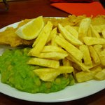 Fish, chips & mushy peas with a slice of lemon