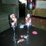 Champagne bottle chilled w/ 2 glasses & chocolates